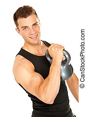 Muscular man lifting dumbbell and looking in camera