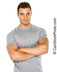 Happy fit male posing over white background