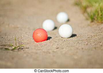 golf balls in sand trap