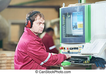 Portrait of carpentry worker with CNC machine - Portrait of...