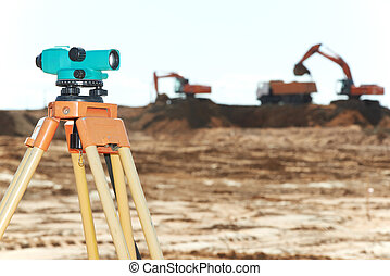 surveyor equipment level at construction site - Surveying...