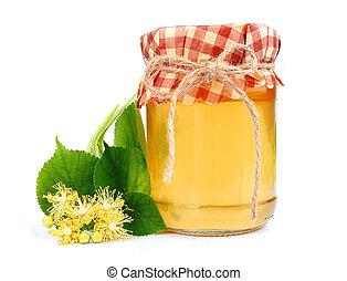 Linden honey with linden flowers.