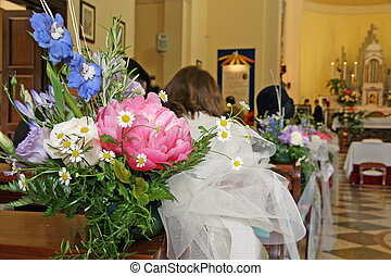 flowers to adorn the nave of the Church during a wedding -...