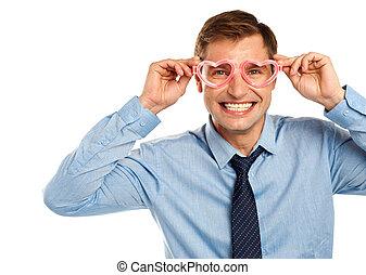 Man wearing heart shaped eye wear - Smiling young man...