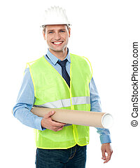 Young architect holding construction map - Young architect...
