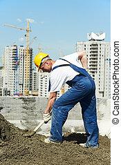 worker roofer with shovel