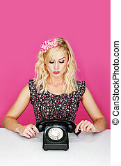 Woman with old telephone - Young woman with old dial up...