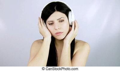Elegant woman listening music sad