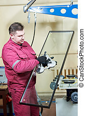 glazier worker with glass - glazier worker with suction cup...