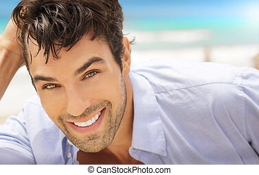 Man with big smile - Great looking young man outdoors with...