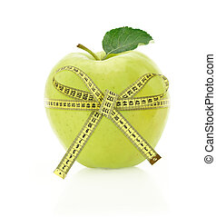 Diet concept Apple with measuring tape