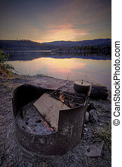 Campground Firepit by Sunset - A campground fire pit near...