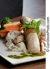 Restaurant style Entree - A plate of sausages, mashed...