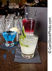 Alcoholic Beverages on a Bartop - Alcoholic beverages of...