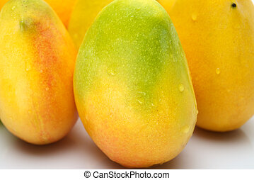 Fresh Mangos - Close up of mangos on white background