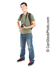 Full length of  asian young man with camera