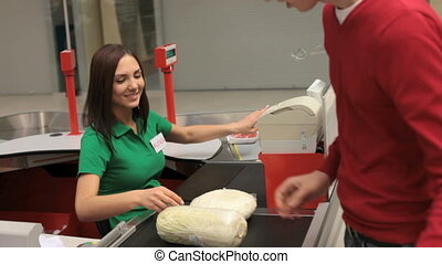Pleasant cashier - Lovely smiling cashier serving the...