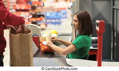 Customer and cashier - Close-up of a customer being serviced...