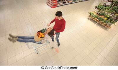 Shopping/dating - Cute young lovers shopping together and...