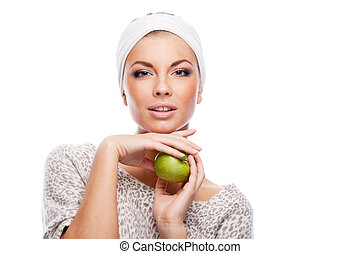 Woman with green apple. Isolated over white.