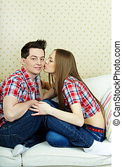 Happy amorous couple - Amorous girl kissing her boyfriend...