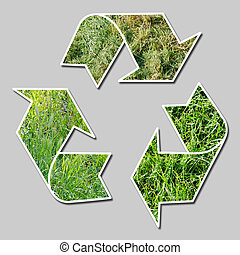 recycle sign with grass - conceptual recycling sign with...