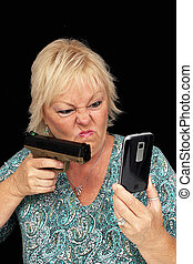 Mature Blonde Woman with Cell Phone and a Handgun 1 - A...