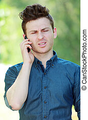Disappointed young man at telephone