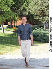 Young man walking in park