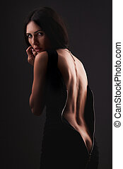 woman in black dress - Pretty woman in black dress with a...
