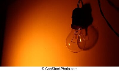 Bulb - Close up of electric tungsten bulb illuminating or...