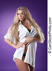 Sexy woman in mens shirt - Young woman in a mens shirt on...