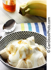 Banana with yoghurt and honey - Healthy snack of Banana with...