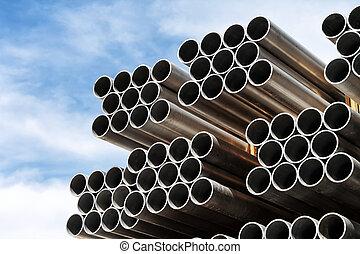 Aluminum tubes. - Aluminium tubes arranged in a row against...