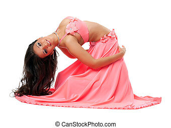 Smiling oriental dancer in pink costume