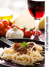 Pasta putanesca - Spaghetti with tomato sauce, capers and...