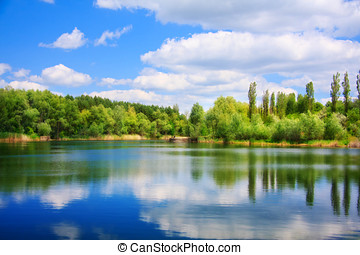 Landscape with a lake - River landscape with sky reflection...