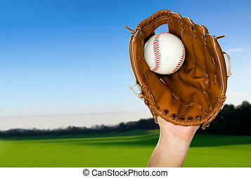 baseball caught in glove outdoors - person catching baseball...