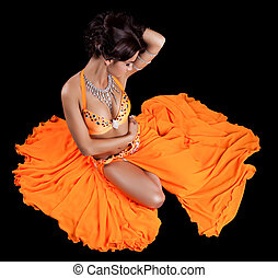 Sexy oriental dancer in orange costume