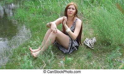 portrait of beautiful young woman in park