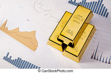 Gold bars with a linear graph - Financial...