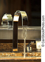 hotel water tap - stainless steel water tap with water goes...