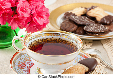 Antique Teacup with Cookies - Hot tea in a vintage teacup on...