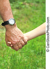 hand of a parent and child