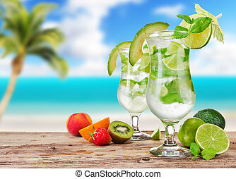 Mojito drinks with blur beach on background