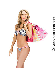 seductive woman in bikini with shopping bags - picture of...