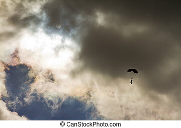 Ominous parachute - Parachute backlit against a ominous...