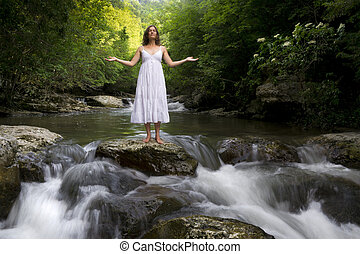 One with Nature - Beautiful young girl enjoying the...