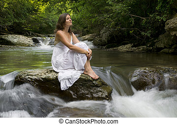 Recharging with Nature - Beautiful young girl enjoying the...