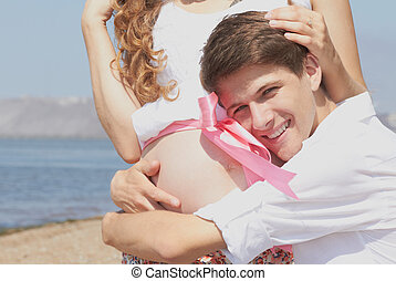 Happy young husband and his pregnant wife - This guy really...